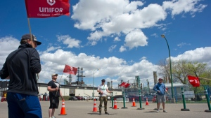 Unifor members social distance on the picket line outside of the Co-op Refinery in Regina, Sask., Wednesday, May 27, 2020. The labour dispute at the Regina refinery is nearing six months. THE CANADIAN PRESS/Mark Taylor
