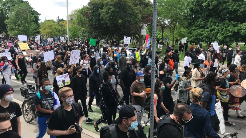 Thousands of people rallied in Toronto the weekend against anti-black racism after Regis Korchinski-Paquet died at age 29. The Special Investigations Unit is investigating her death after she fell from a balcony. The woman's mother said last week that she had called police to the apartment and asked them to take her daughter to the Centre for Addiction and Mental Health.