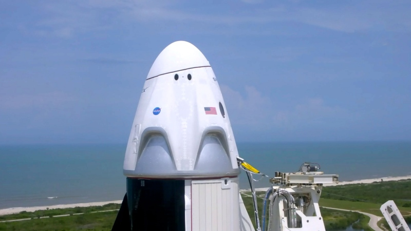 In this image made from video via NASA-TV, a SpaceX Falcon 9, with NASA astronauts Doug Hurley and Bob Behnken in the Dragon crew capsule, prepare to lift off from Pad 39-A at the Kennedy Space Center in Cape Canaveral, Fla., Saturday, May 30, 2020. The two astronauts are on the SpaceX test flight to the International Space Station. (NASA via AP)