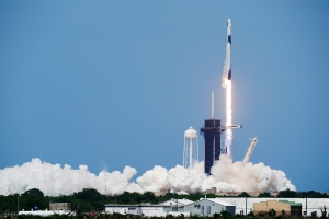 A SpaceX Falcon 9, with NASA astronauts Doug Hurley and Bob Behnken in the Dragon crew capsule, lifts off from Pad 39-A at the Kennedy Space Center in Cape Canaveral, Fla., Saturday, May 30, 2020. For the first time in nearly a decade, astronauts blasted towards orbit aboard an American rocket from American soil, a first for a private company. (AP Photo/David J. Philip)