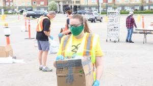 Alyson Howey helps collect bottles May 30, 2020. (Chad Leroux/CTV Saskatoon)