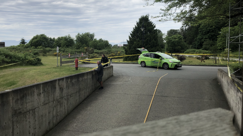 A photo taken by a resident of Tsatsu Shores Drive near the Tsawwassen ferry terminal shows a taxi cab from Delta Surrey Green Cab behind police tape.