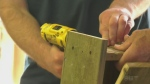 Family building birdhouses to help local food bank