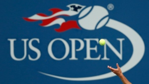 In this Sept. 2, 2017, file photo, Philipp Kohlschreiber, of Germany, serves to John Millman, of Australia, during the third round of the U.S. Open tennis tournament in New York. A high-ranking official for the U.S. Open tells the Associated Press that if the Grand Slam tennis tournament is held in 2020, she expects it to be at its usual site in New York and in its usual dates starting in August. (AP Photo/Adam Hunger, File)
