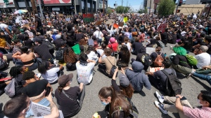 Peoples sit on at an intersection during a protest over the death of George Floyd in Los Angeles, Saturday, May 30, 2020. Protests across the country have escalated over the death of George Floyd who died after being restrained by Minneapolis police officers on Memorial Day, May 25. (AP Photo/Ringo H.W. Chiu)