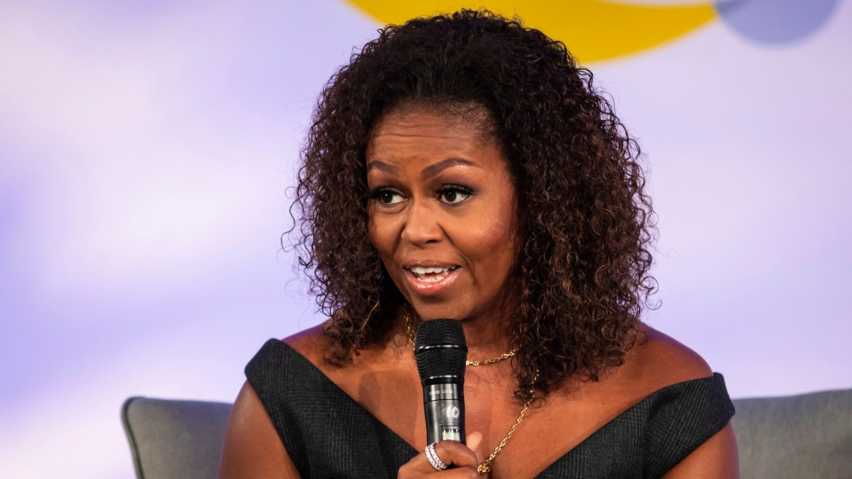 Former first lady Michelle Obama speaks during the Obama Foundation Summit at the Illinois Institute of Technology in Chicago, Tuesday, Oct. 29, 2019. (Ashlee Rezin Garcia/Chicago Sun-Times via AP)