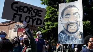 Protesters gather Saturday, May 30, 2020, in Minneapolis. Protests continued following the death of George Floyd, who died after being restrained by Minneapolis police officers on Memorial Day, May 25. (AP Photo/John Minchillo)