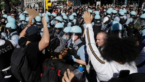 Chicago Police prepare and organize to address protesters over the death of George Floyd in Chicago, Saturday, May 30, 2020. Protests were held throughout the country over the death of George Floyd, a black man who died after being restrained by Minneapolis police officers on May 25. (AP Photo/Nam Y. Huh)