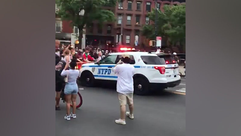 Police are investigating after a video appeared to show a New York City Police Department truck plowing through a crowd during Saturday's protests over the death of George Floyd. (chieffymac11/Twitter/CNN)