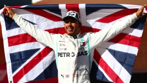 Lewis Hamilton celebrates after clinching his sixth Formula One world title. (Dan Istitene/Getty Images North America/Getty Images/CNN)