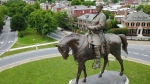 This Tuesday June 27, 2017 file photo shows the statue of Confederate General Robert E. Lee that stands in the middle of a traffic circle on Monument Avenue in Richmond, Va. Many of the Confederate monuments scattered around the state could soon be coming down after new legislation passed the Virginia legislature. (AP Photo/Steve Helber)