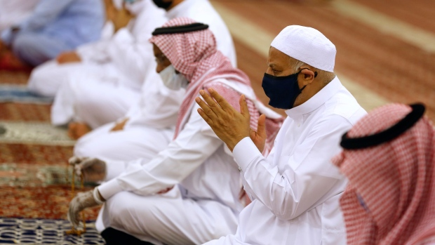 Worshippers wearing face masks to prevent the spread of COVID-19 prays at al-Mirabi Mosque in Jiddah, Saudi Arabia, Sunday, May 31, 2020. (AP Photo/Amr Nabil)