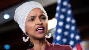 "Rep. Ilhan Omar, D-Minn., respond to remarks by President Donald Trump after his call for the four Democratic congresswomen to go back to their ""broken"" countries, during a news conference at the Capitol in Washington, Monday, July 15, 2019. All are American citizens and three of the four were born in the U.S. (AP Photo/J. Scott Applewhite)"