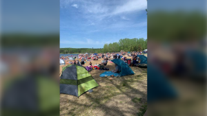A photo taken Saturday, May 30 2020 at the Wabamun Lake Provincial Park showed the beach filled with people. (Supplied)