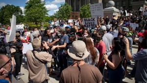 A crowd of protesters turn to confront a counter-protester during a heated moment that organizers at the Idaho Statehouse Sunday, May 31, 2020 in Boise. Protesters were demonstrating over the death of George Floyd, a black man who was in police custody in Minneapolis. Floyd died after being restrained by Minneapolis police officers on May 25. (Darin Oswald/Idaho Statesman via AP)