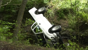 Crews work to remove a pickup truck from a creek after a single-vehicle crash in Metchosin Sunday. (CTV)