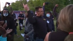 Screenshot from footage showing Genesee County Sheriff Chris Swanson talking to protesters in Flint, Mich., on Saturday, May 30.