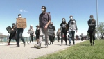 The Walk for Justice organized by the Coalition for Justice, Unity and Equity in honour of George Floyd and to protest police violence against black people drew hundreds to Windsor's waterfront on Sunday, May 31, 2020. (Ricardo Veneza / CTV Windsor)