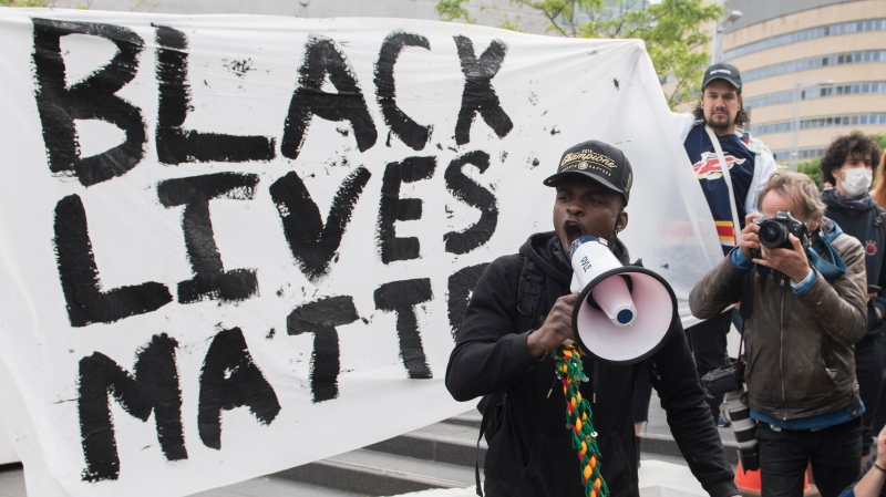 A man speaks during a demonstration where they called for justice for George Floyd and all victims of police brutality in Montreal, Sunday, May 31, 2020.THE CANADIAN PRESS/Graham Hughes