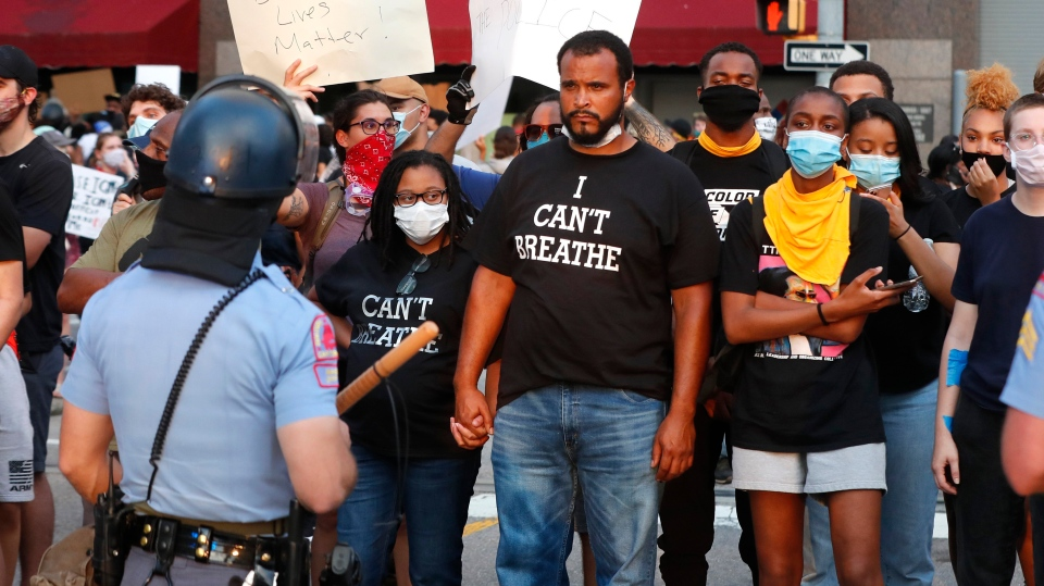Demonstrators face off with police in riot gear in downtown Raleigh, N.C., Saturday, May 30, 2020 during a protest over the death of George Floyd, who died in police custody on Memorial Day in Minneapolis. (Ethan Hyman/The News & Observer via AP)