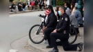 Police kneel with Michigan protesters