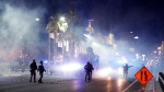 Las Vegas Police disperse protesters with gas on the Las Vegas Strip on Sunday, May 31, 2020, in Las Vegas, over the death of George Floyd, who died May 25 after he was pinned at the neck by a Minneapolis police officer. (AP Photo/Steve Marcus)