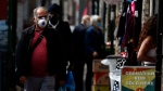 Customers stroll through Shepherd's bush market that is allowed to reopen after the COVID-19 lockdown in London, Monday, June 1, 2020. The British government has lifted some lockdown restrictions to restart social life and activate the economy while still endeavouring to limit the spread of the highly contagious COVID-19 coronavirus.(AP Photo/Frank Augstein)