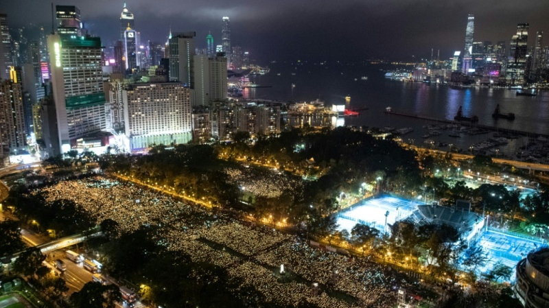 Candlelight vigils in Hong Kong marking the anniversary of the Tiananmen crackdown usually attract hundreds of thousands of people, as this one in Victoria Park did in 2019. (AFP)
