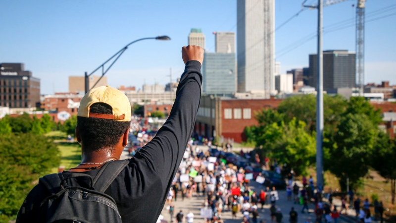 Protesters shut down eastbound I-244 during a protest march in Tulsa, Okla., Sunday, May 31, 2020. The march was in honor of the 99th anniversary the Tulsa Race Massacre and George Floyd who died after being restrained by Minneapolis police officers on May 25. (Ian Maule/Tulsa World via AP)
