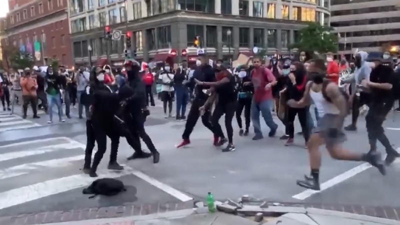 Protesters tackle alleged sidewalk vandal in D.C.