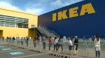 Customers line up outside IKEA in Dartmouth, N.S., as the store reopens its doors on June 1, 2020.