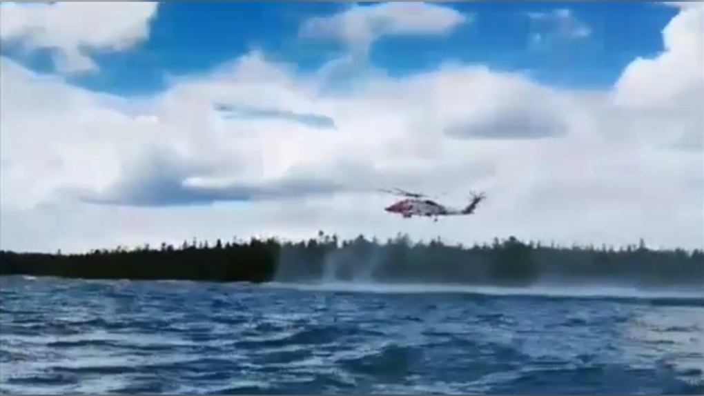 Helicopter rescue of two kayakers in Lake Huron
