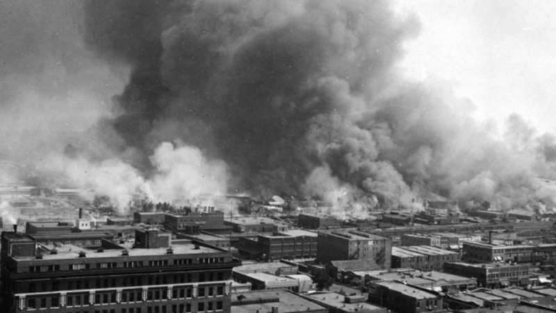 A black and white image showing the destruction during the Tulsa race massacre that took place on May 31 and June 1, 1921. (Credit: United States Library of Congress via Wikimedia)