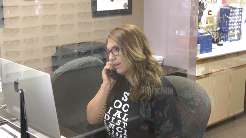 Sault Ste. Marie optometrist office employee sits behind Plexiglas. June 1/20 (Jairus Patterson/CTV Northern Ontario)