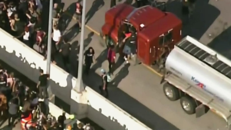 Truck driven through crowd of protesters