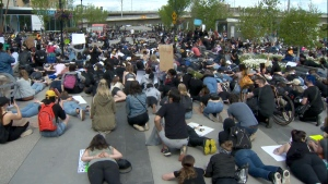 Hundreds of people gather in downtown Calgary as part of a rally against racism.
