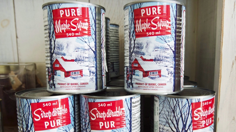 Maple syrup cans are seen at a sugar shack Friday, February 10, 2017 in Oka, Quebec. The Quebec Maple Syrup Producers says they set a new record for maple syrup production this year. The producers say this year's harvest is estimated at more than 175 million pounds of maple syrup for all of Quebec, an average yield of 3.59 pounds per tap. THE CANADIAN PRESS/Ryan Remiorz