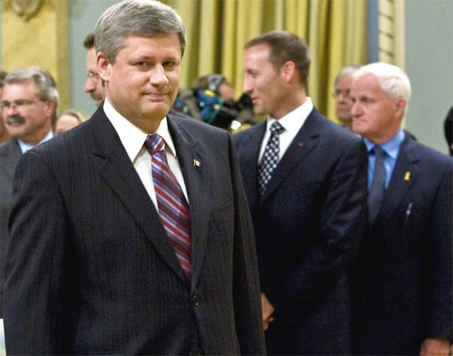 Prime Minister Stephen Harper walks past Peter MacKay and Gordon O'Connor, as he arrives for swearing-in ceremonies at Rideau Hall Tuesday, August 14, 2007 in Ottawa. (CP / Fred Chartrand)