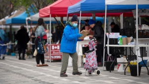 The Ottawa Farmers' Market at Lansdowne Park in Ottawa, which opened for online order pickups only due to the COVID-19 pandemic, is quiet as organizers worked to limit the number of people on premises by issuing time slots for their customers to arrive, on Sunday, May 31, 2020. (Justin Tang/THE CANADIAN PRESS)