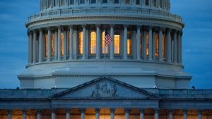 In this May 3, 2020, file photo, light shines from inside the U.S. Capitol dome at dusk on Capitol Hill in Washington. (AP Photo/Patrick Semansky)