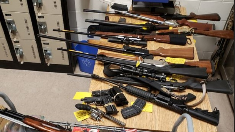 Nottawasaga OPP displays weapons allegedly seized during a search at a Barrie residence on Mon., June 1, 2020. (Supplied)