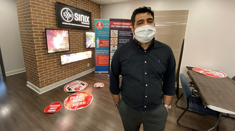 Ottawa Print Services C.E.O. Hamed Zadeh now produces safety stickers and protective barriers in a switch from his previous services. June 1, 2020. Ottawa, ON. (Tyler Fleming / CTV News Ottawa)
