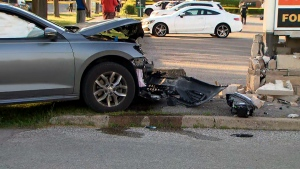 A vehicle crash into a plaza sign is seen in Scarborough on June 1, 2020.
