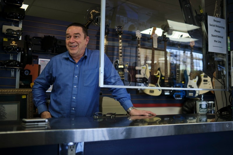 John Sanford, co-owner of Rocky Mountain Pawn, speaks about the business in Calgary, Alta., Wednesday, May 27, 2020, amid a worldwide COVID-19 pandemic. (THE CANADIAN PRESS/Jeff McIntosh)