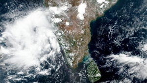 This May 31, 2020, satellite image released by NASA shows Cyclone Nisarga roaring toward the western coast of India. Indian Meteorological Department (IMD) authorities say that the cyclone brewing in the Arabian sea is expected to cross very close to India's western coast on Wednesday, June 3, 2020. (NASA Worldview, Earth Observing System Data and Information System (EOSDIS) via AP)