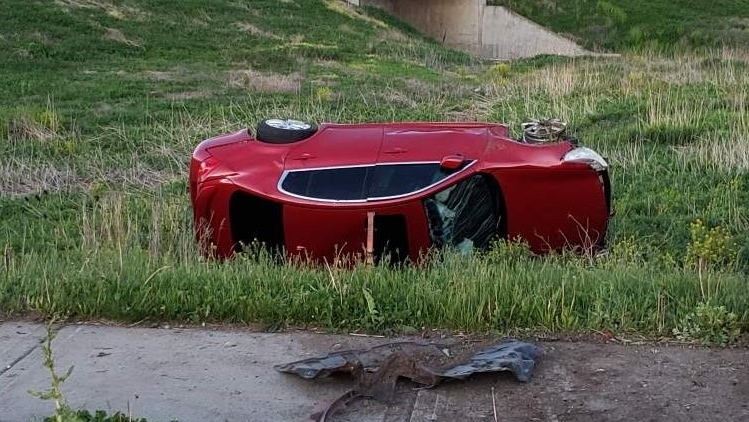 The OPP's highway safety division posted a tweet of the scene on Tuesday that showed a red car flipped onto its side with substantial damage. (Photo/@OPP_HSD)