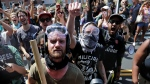 "Anti-fascist counter-protesters wait outside Lee Park to hurl insluts as white nationalists, neo-Nazis and members of the ""alt-right"" are forced out after the ""Unite the Right"" rally was declared an unlawful gathering August 12, 2017 in Charlottesville, Virginia. (Chip Somodevilla/Getty Images)"
