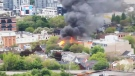 Fire is seen at a home on Queen Street East in Corktown on June 2, 2020. (Twitter/@mcharlin)
