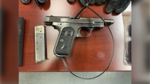 A gun Ontario Provincial Police say was seized during a traffic stop on Highway 401 near Kingston, Ont. early Tues. June 2, 2020. (OPP handout)