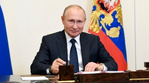 Russian President Vladimir Putin, attends a meeting via teleconference at the Novo-Ogaryovo residence outside Moscow, Russia, Monday, June 1, 2020. Putin set a nationwide vote on constitutional amendments allowing him to extend his rule for July 1. (Alexei Nikolsky, Sputnik, Kremlin Pool Photo via AP)
